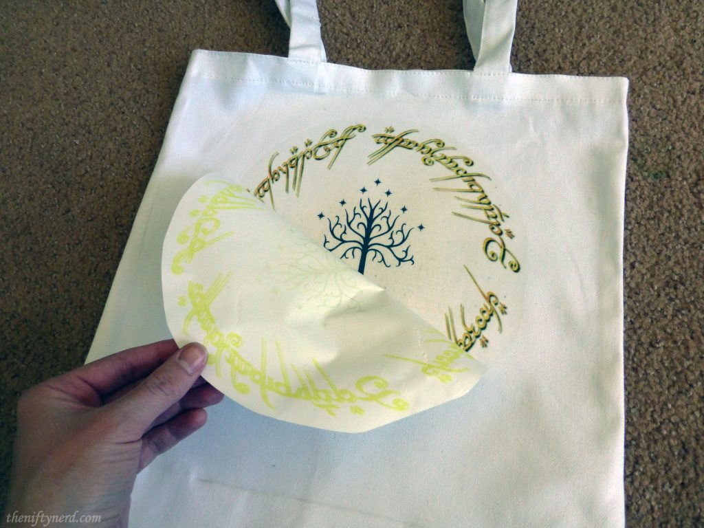peeling back the trasnfer paper on my Lord of the Rings tote bag