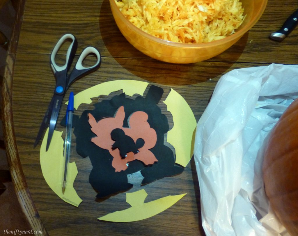 Cutting out a pokemon pumpkin carving template