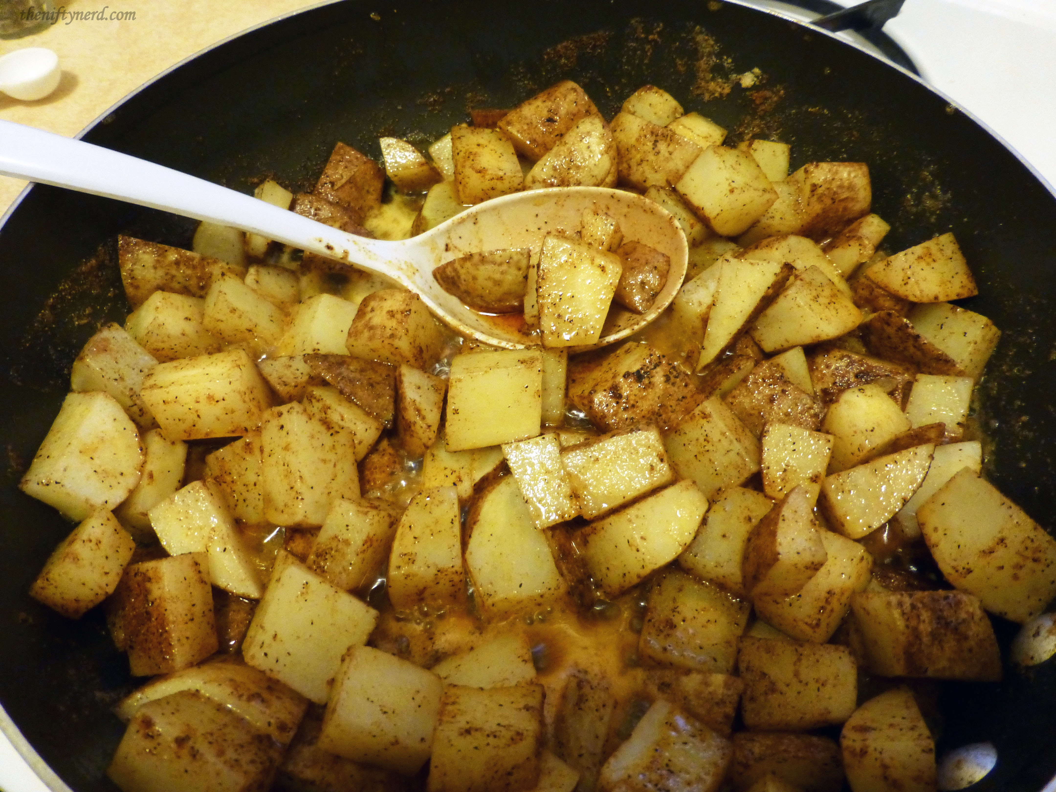 cooking Otik's spiced potatoes