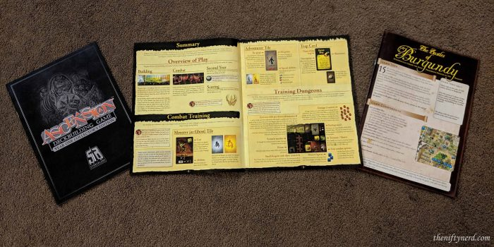 Ascension, Lords of Waterdeep, and Castles of Burgundy rule books