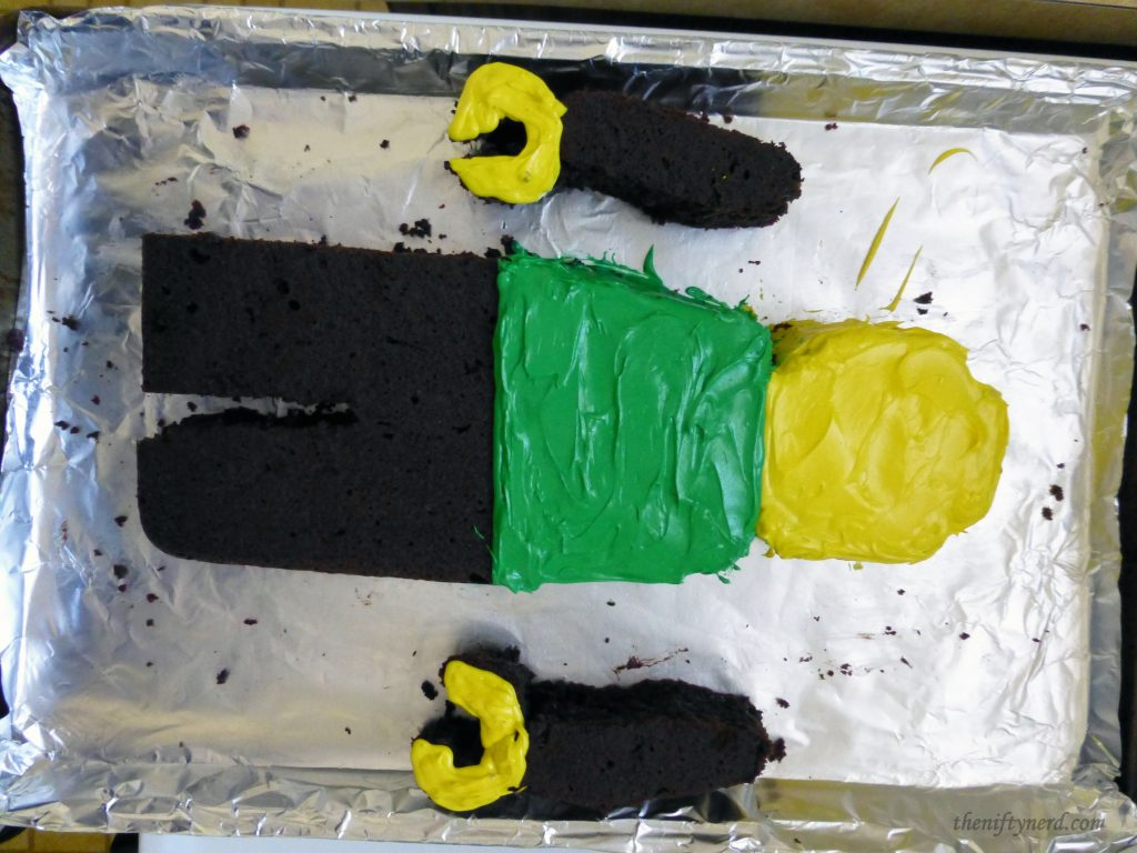 frosting a Lego cake man