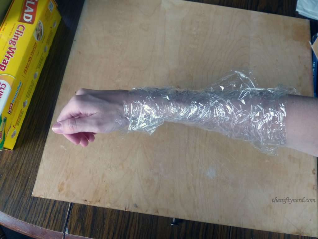 arm wrapped in seran wrap