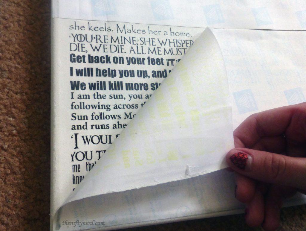 peeling back the transfer paper