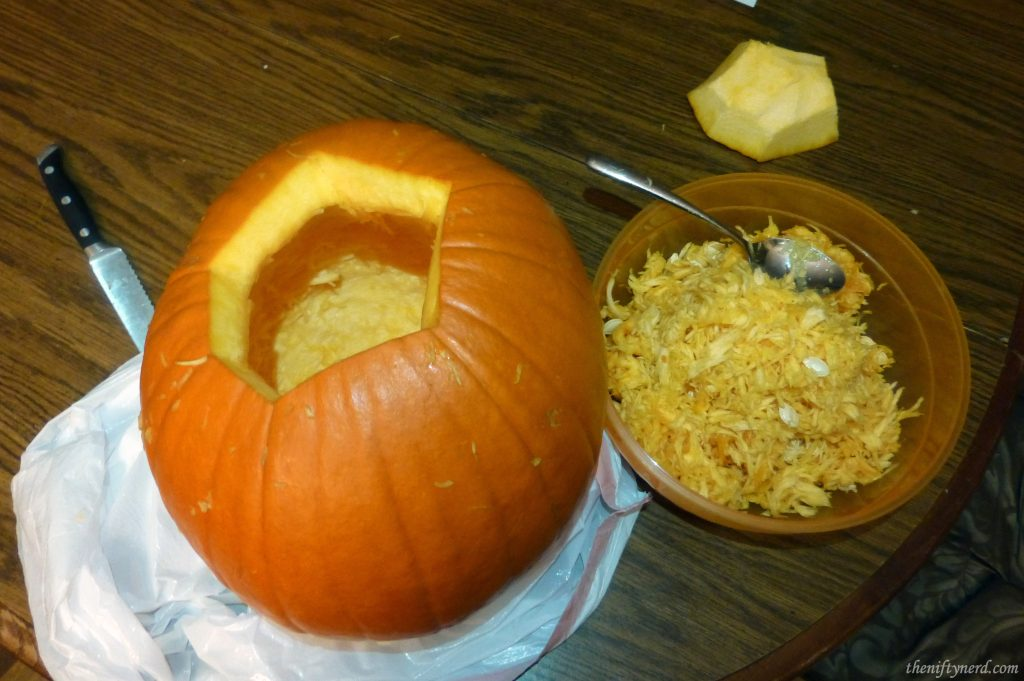 Cleaning out a pumpkin for carving