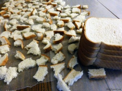 tearing bread for homemade stuffing