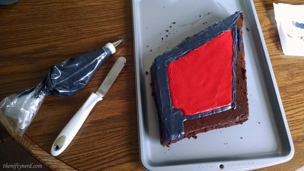 Frosting the diamond shaped Horde crest cake