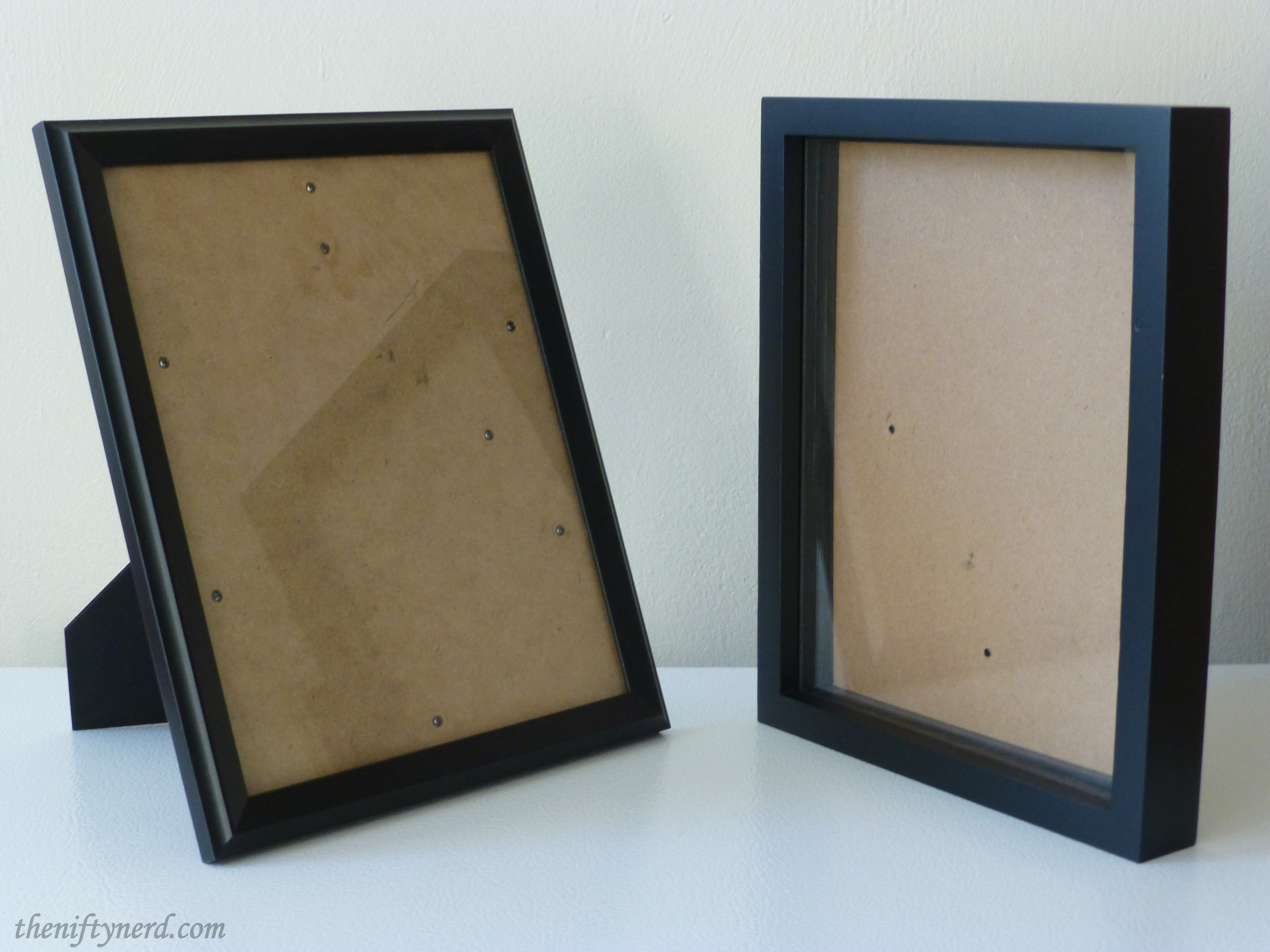 empty black picture frame and shadow box