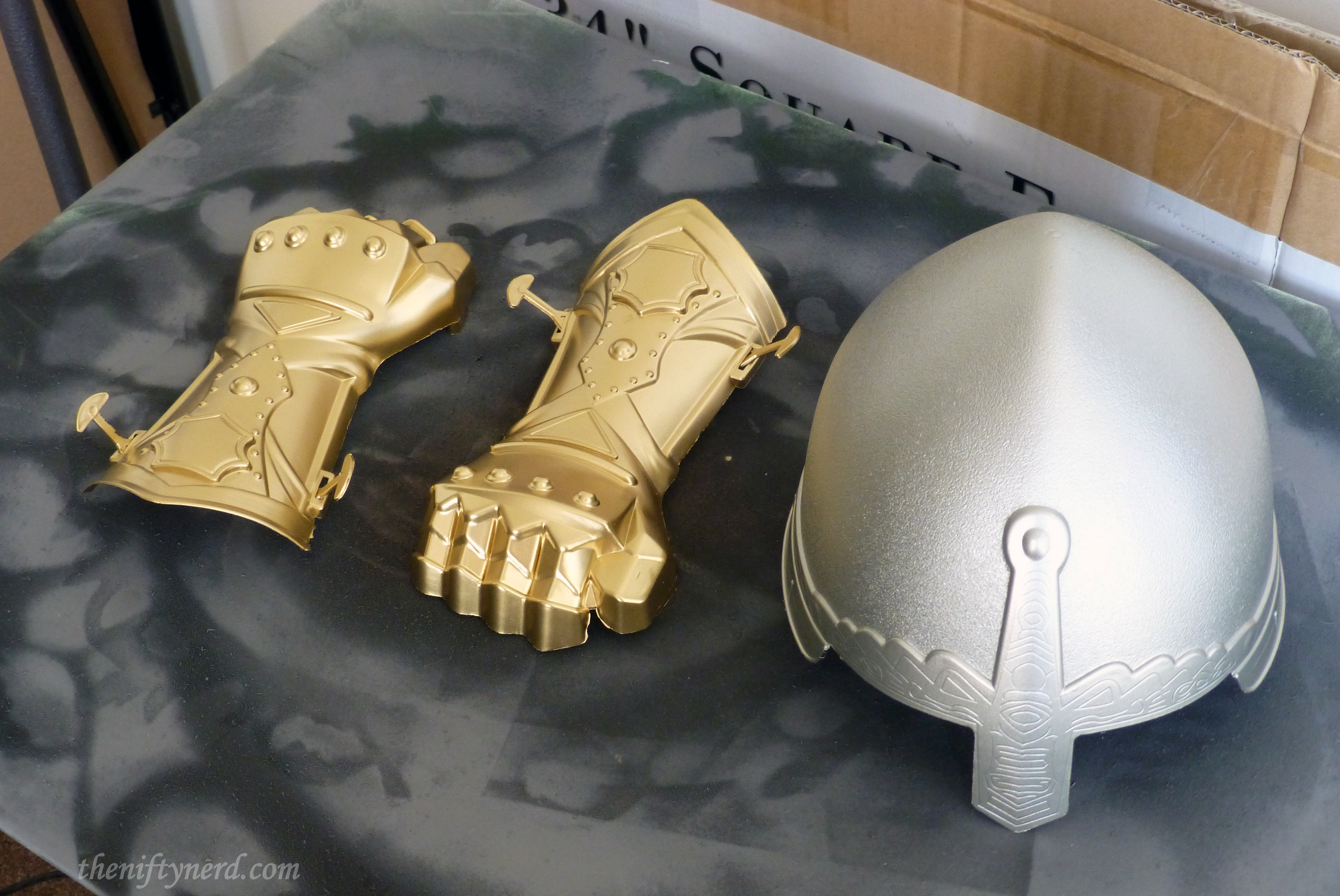 spray painted toy gauntlets and helmet