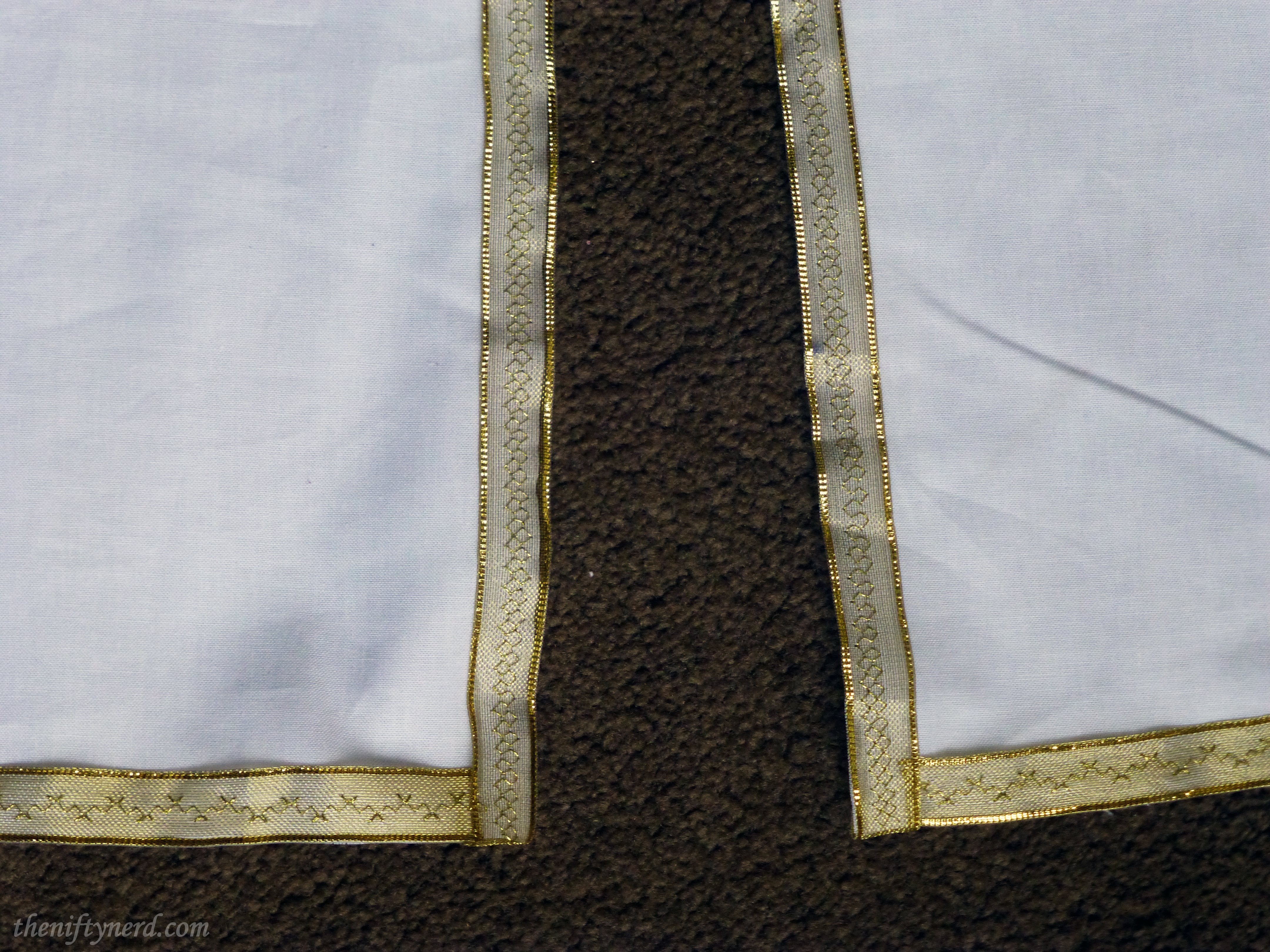 trim on King Arthur's tunic