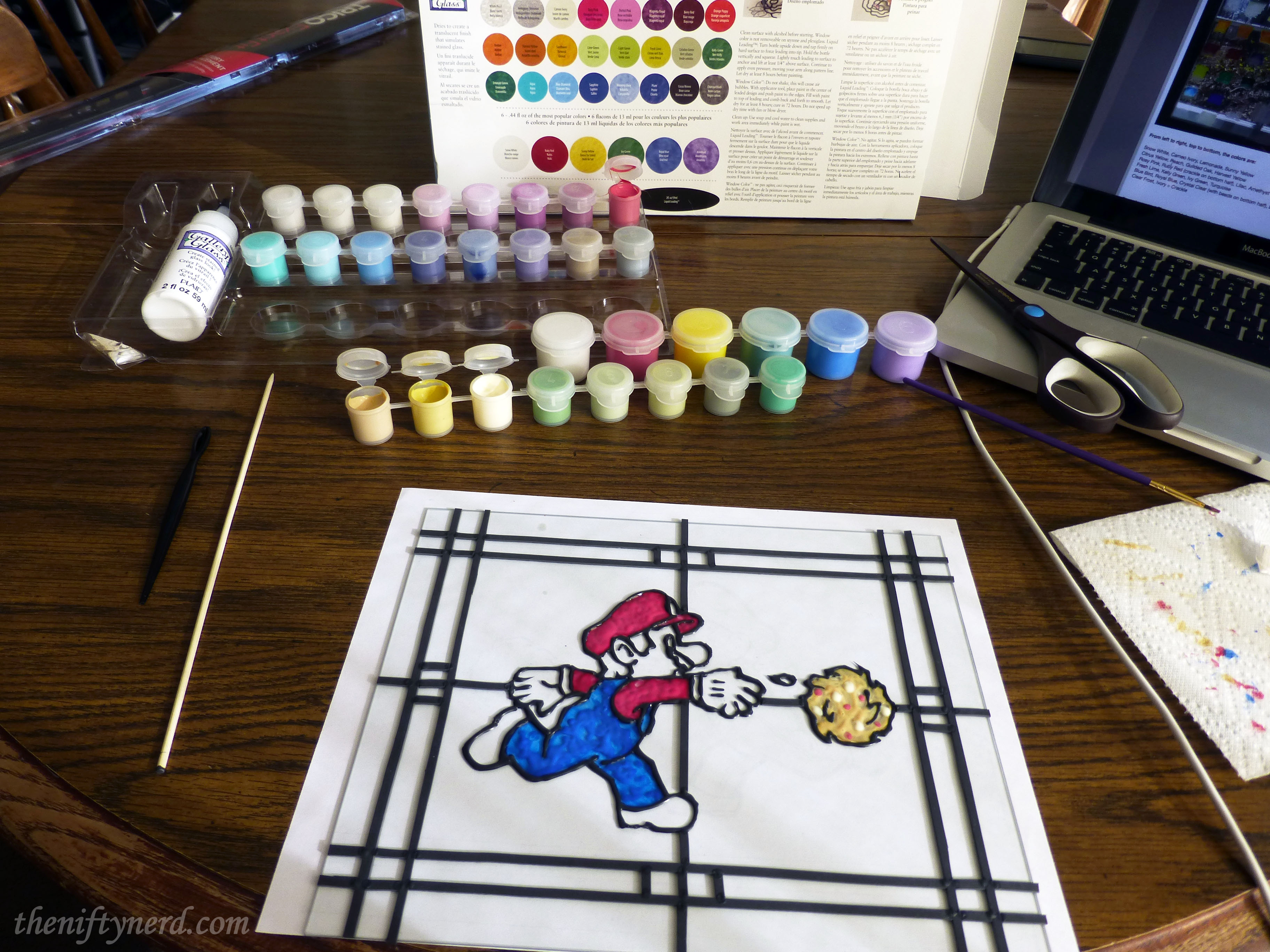 using color stained glass paint to fill in the mario outline