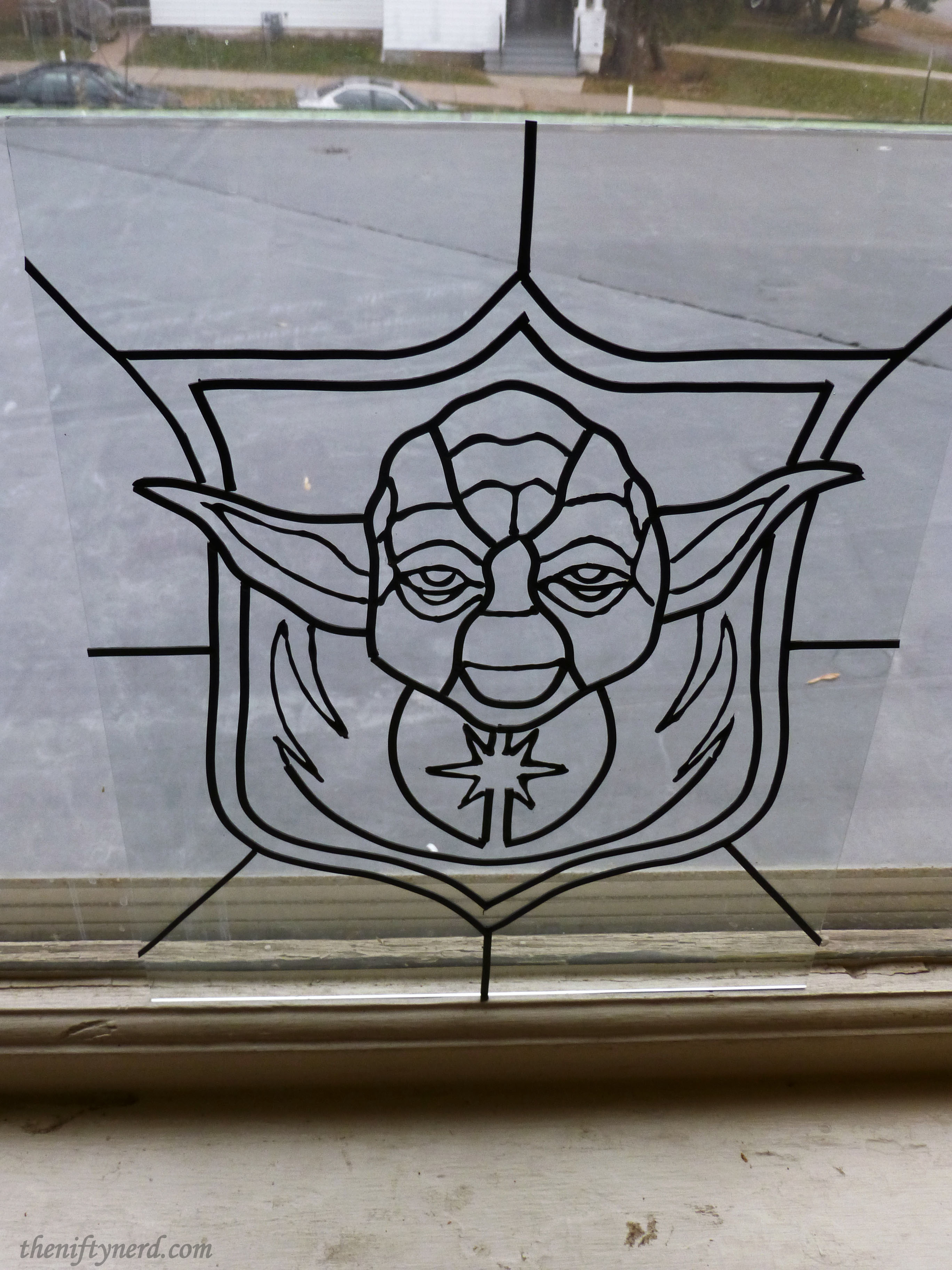 Outline of Yoda ready for stained glass paint