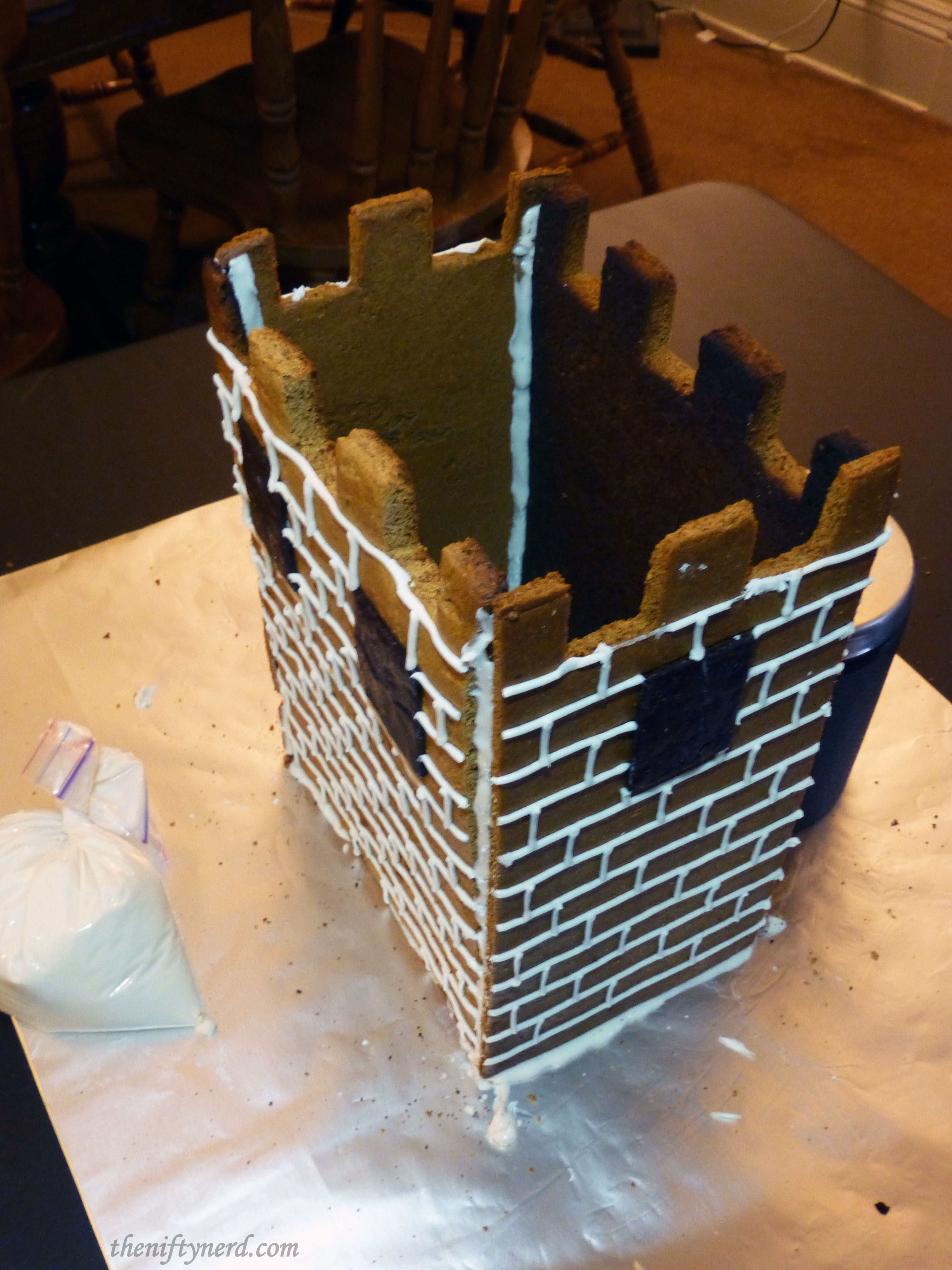 gluing the castle walls with royal icing