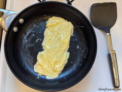 cooking an egg in a frying pan